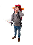 Young backpacker tourist looking map in stress lost and confused Stock Image