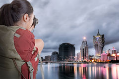 Young backpacker travel and take picture Stock Photography