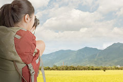 Young backpacker travel and take picture Stock Images