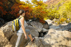 Young backpacker traveling along mountain trails. Stock Photos
