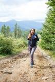 Young backpacker woman enjoying mountain trip Stock Image