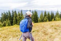 Young backpacker woman enjoying mountain trip Stock Photo