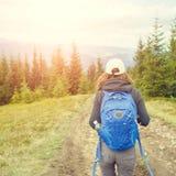 Young backpacker woman enjoying mountain trip Royalty Free Stock Photos