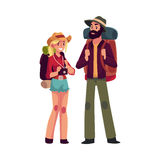 Young backpackers with backpacks, sleeping bags and camera, travelling together Royalty Free Stock Photo