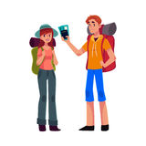 Young backpackers with backpacks, sleeping bags and camera, travelling together Stock Photo