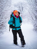 Young backpacking woman enjoy nature in beautiful winter forest Stock Images