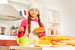 Young baker with fresh bakery food at the kitchen Stock Photo