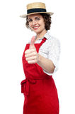 Young baker woman gesturing thumbs up Royalty Free Stock Image