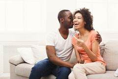 Young african-american couple happy about results of pregnancy test stock image