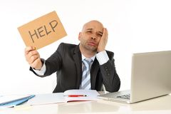 Young bald attractive business man bored with computer at work. Young bald attractive business man in stress overworked with computer asking for help at work Royalty Free Stock Photo