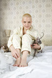Young  bald blond woman wearing pyjamas Stock Photo