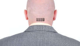 Young bald businessman from his back with barcode. Young bald businessman from his back Stock Photo