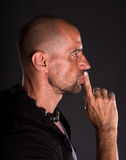 Young bald handsome man showing silence gesture Royalty Free Stock Image