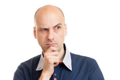 Young bald man doubting Royalty Free Stock Photography