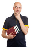 Young bald man holding books Royalty Free Stock Photos