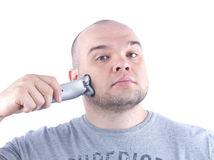 Young bald man shaving Stock Photo