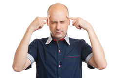 Young bald man thinking too hard. Portrait of young bald man thinking too hard. Isolated Stock Photography