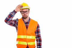 Young bald muscular man construction worker. Holding safety helmet on head stock image