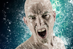 Young bald head man surrounded by splashing water advertising shot Stock Photos