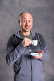 Young baldheaded man drinking coffee Royalty Free Stock Photos