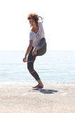 Young balerina dancing on the beach Stock Images