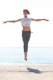 Young balerina dancing on the beach Stock Photography