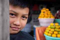 Young Balinese boy. BALI - JANUARY 20. Son of a Balinese fruit stall owner family selling his postcards in Bali on January 20, 2012 in Bali, Indonesia. All Stock Photography