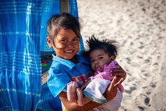 Young balinese girl holding her brother Royalty Free Stock Photo