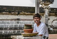 The young Balinese man in the Pura Lempuyang temple stock photo