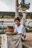 The young Balinese man in the Pura Lempuyang temple royalty free stock images