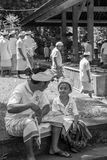 Young Balinese son and hist father during religious ceremony in Stock Images