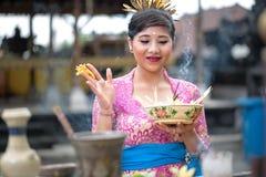 Young Balinese woman praying Royalty Free Stock Photos