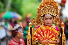 Young Balinese women in golden headdress. Denpasar, Bali island, Indonesia - June 23, 2018: Face portrait of beautiful young woman in traditional Balinese dance royalty free stock images