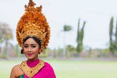Young Balinese women in golden headdress. Denpasar, Bali island, Indonesia - June 23, 2018: Face portrait of beautiful young woman in traditional Balinese dance stock photography
