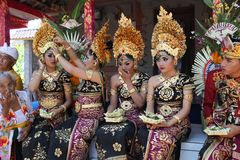 Young Balinese women and a man decorated due to the Potong Gigi ceremony - Cutting Teeth, Bali Island, Indonesia royalty free stock photo