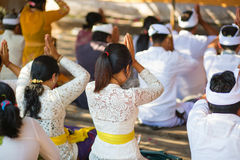 Young Balinese women praying in a temple Royalty Free Stock Images