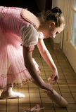 Young ballerina. Puts on pointe  before appearance Stock Photo