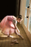 Young ballerina. Puts on pointe  before appearance Stock Image