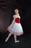 Young ballerina. Young ballet dancer or ballerina with dark background Royalty Free Stock Image