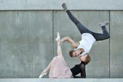Couple dancing on city street stock photos