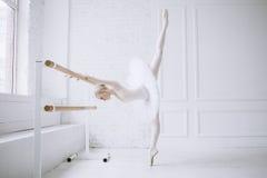 Young ballerina in ballet class stock photography