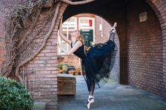 Ballerina dancing on the street stock photography