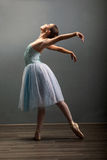 Young ballerina in ballet pose classical dance Stock Image