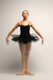 Young Ballerina in black tutu Stock Images