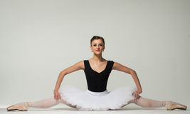 Young ballerina dancer. Beautiful young ballerina dancer sitting on a floor royalty free stock images