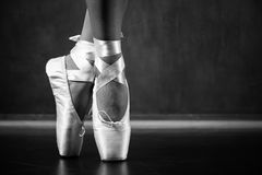 Young ballerina dancing. Closeup on legs and shoes Stock Photo