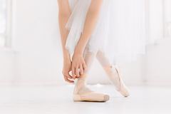 Young ballerina dancing, closeup on legs and shoes, standing in pointe position. Young ballerina dancing, closeup on legs and hands and shoes, standing in stock image
