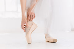 Young ballerina dancing, closeup on legs and shoes, standing in pointe position. stock image