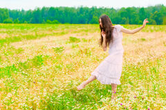 Young ballerina dancing in  field with daisies Royalty Free Stock Images