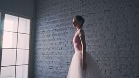 Young ballerina dancing in the hall. Beautiful ballerina dancing in the hall stock footage